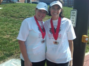 Showing off our medals after the Columbus 1/2 marathon